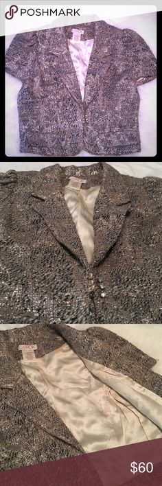 LaRok metallic tweed silk lined jacket This cropped LaRok metallic short sleeved jacket is the perfect party jacket! It's silk lined and has crystal buttons on the front and on each sleeve. Black, beige, gold and silver tweed and metallic thread. Size Med LaRok Jackets & Coats Blazers