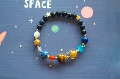 Do you love the solar system? Would you like to have them in your hand? Then your wait is finished here with the handcrafted solar bracelets with unique gemstone planets and gold stars. This bracelets have the planets aligned in a beautifully crafted solar system by hand. You can even wear one or all together as per your preference. #Celestial Style Solar System Bracelet #Solar Bracelet #Solar Planet Bracelet #Solar System Bracelet #Spectacular Celestial Style Solar System