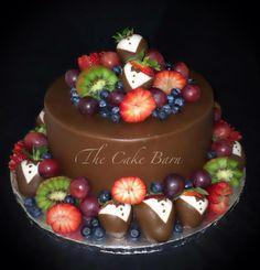 Grooms cake embellished with fruit #thecakebarn #chocolatecoveredstrawberries #groomscake