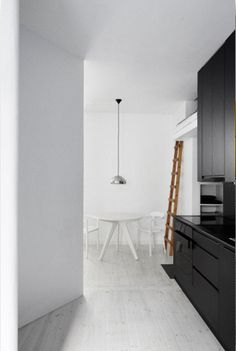 black kitchen, strong contrast to otherwise white interior