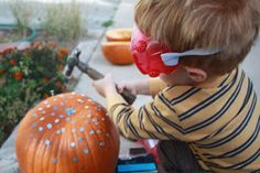 Kids' stuff - Play, Make, Learn: using real nails to hammer pumpkin - helps motor skills and hand-eye co-ordination - also keeps them busy for ages, so have a good stock of nails and pumpkins LOL! ;) Mo