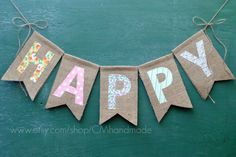"make an Easter Bunting in this style:  Double-layered 5"" x 8"" burlap chevron-style flags,  stitched with a variety of fun cotton fabric & lace letters,  strung onto 3 yards of jute twine."