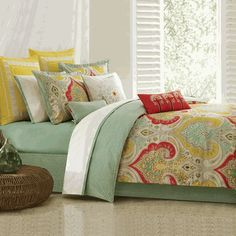 Vibrant shades of yellow, aqua, and red enhance this boldly-scaled 100% cotton print comforter.