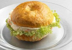 Bagel with Lox and Cream Cheese!  Top a small whole grain bagel (great source of fiber) with canned salmon (omega-3s) and low-fat cream cheese for a healthy breakfast that feels more indulgent than it is. The key is portion control—avoid huge calorie-bomb bagels.    Read more: http://www.prevention.com/food/healthy-eating-tips/power-breakfasts-energy/bagel-lox-and-cream-cheese.