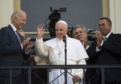 Pope Francis waves, flanked by Vice President Joe Biden (left) and House Speaker John Boehner (right... - Andrew Caballero-Reynolds/AFP/Getty Images