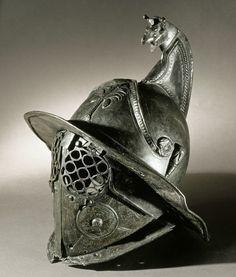 "Pompeii: Bronze helmet of a 'Thracian' (Thrax) gladiator. 1st c. AD. ""Pompeii - The Life Of A Roman Town | Folio Illustrated Book (Electa/akg-images)"""
