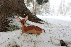 A white-tail deer fawn on an winter's day - pattern for a felt ornament.