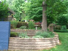 Pretty Retaining Wall.  This seems like a good solution to ending the wall...creeping it back up?