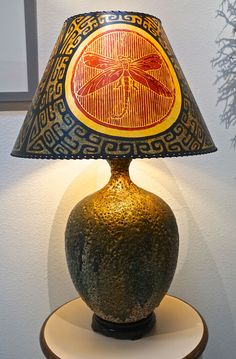 this is a stunning vintage lava glaze pottery lamp base in shades of green creme