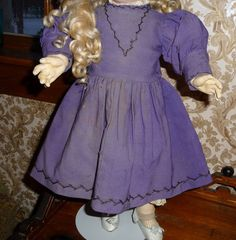 Beautiful antique purple doll dress with feather stitching