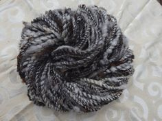 Rowdy Zebra handspun bulky yarn with fluffy locks of Jacob