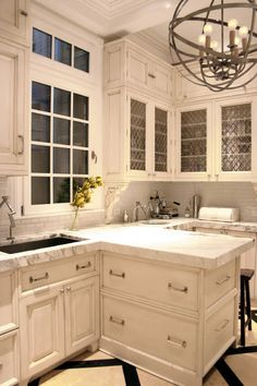 Kitchen Workbook: 15 Elements of a Traditional Style Kitchen /  MY FAVORITE STYLE! Love the glazed, antiqued white or black cabinets with a few glass fronts (especially the HIGH OVERHEAD CABINETS), Carerra marble counters, slide out drawers down below, ambient lighting, wrought iron pendent. Houzz.com