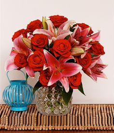 RASPBERRY   Rose & Stargazer Lily Flowers   A vibrant blend of red roses and pink lilies can convey one's feelings of love and likeness at the same time to your loved one.