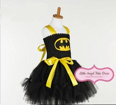 Check out this item in my Etsy shop https://www.etsy.com/uk/listing/479534677/batgirl-inspired-tutu-dress-batman-tutu