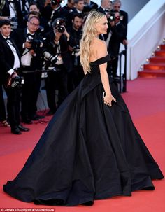 Stunning:With its voluminous skirt and eye-catching train, the blonde beauty ensured she ...