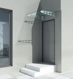 Pensilina con supporti inferiori in acciaio inox aisi 304 finitura satinata e vetro stratificato temperato trasparente