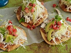 Chicken Tostadas : Fry tortillas until very crispy (otherwise they will become rubbery), then top them with a mixture of chicken, beans, avocado, lettuce and salsa.