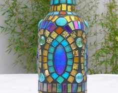 Check out our mosaic artmosaiced bottles selection for the very best in unique or custom, handmade pieces from our shops. Mosaic Bottles, Mosaic Vase, Mosaic Projects, Recycled Art, Bottle Art, Art Object, Painted Rocks, Creative Ideas, Stained Glass