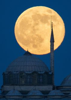 A supermoon rises behind a building of the Topkapi Palace in Istanbul.