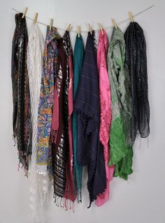 Instead of buying an expensive scarf hangar, string a line at the back of your closet then use clothes pins to hold scarves