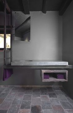 Bathroom interior by Dirk Cousaert. Blue stone + iron + oak.
