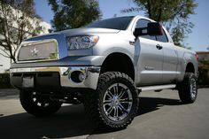 Silver Toyota Tundra with RBP Chrome Grille and 94R Chrome with Black Inserts Wheels.