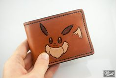 Eevee hand-made leather wallet. | Community Post: 28 Geeky Pokémon Items On Etsy