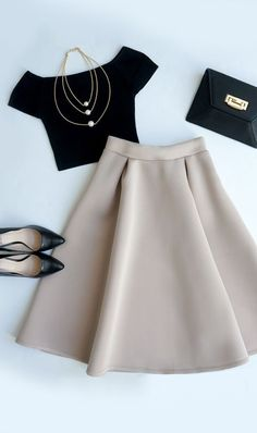 Crop top, long full skirt, flats, a clutch, and a pearl necklace. So chic for a holiday party.