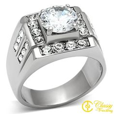 """Classy Not Trashy Men's Fashion Jewelry Ring, Premium Grade Stainless Steel Clear Cubic Zirconia CZ Round Cut Ring Size 9. This Men's Ring makes the perfect gift. HIGH-QUALITY- Premium Materials used. Includes gold foiled imprinted """"Classy Not Trashy"""" gift box with ribbon and soft polishing cloth. GREAT FOR ALL OCCASIONS: Look great while creating memories with loved ones. PERFECT GIFT for that special person in your life. 100% GUARANTEE & WARRANTY - Feel secure with our world class…"""
