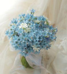 水色のクラッチブーケ ブルースター ホテルニューグランド様へ : 一会 ウエディングの花