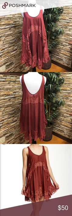 Free People slip Free People She Swings Slip.  Lace inserts.  Uneven hem.  Extra swingy.  Maroon color.  Never worn.  New without tags.  Excellent condition. Free People Dresses