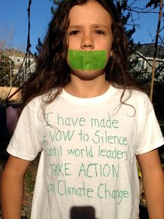 """His T-shirt explains, """"I am taking a vow of silence until world leaders take action on climate change."""""""