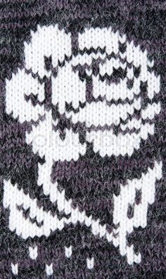 Stock Photo of 'knitted gray background with a pattern in the form of a flower'