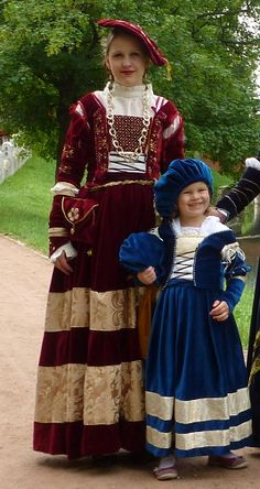 Red Cranach dress and small blue version by Blaue Rose