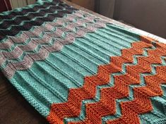 "Danielle offers a pattern for ""the Walt"" afghan, which features raised stripes of garter Chevron that give baby a nice texture to play with. Select a neutral with lots of bold stripes or choose a bright background to put neutral and colorful stripes over. Pattern at click"