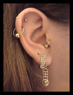 cute cartilage piercing with two love piercings and a tragus piercing.