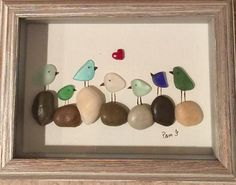 Framed Birds Picture all created using Genuine Sea Glass. Placed inside a 5 x 7 inch glassed rustic wood shadow box frame. Thank you ❤️ for looking! To visit my shop go to: https://www.etsy.com/shop/LifeCreationDesign?ref=hdr_shop_menu