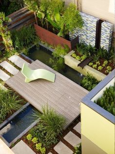 Modern garden with pond in a small backyard space.