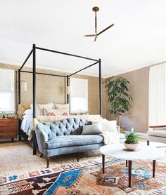 This epic slumber chamber by the inimitable Amber Lewis of Amber Interiors is the epitome of maximalist chic. The warmth of texture floor to ceiling (and walls) surrounds you for one gigantic (and...