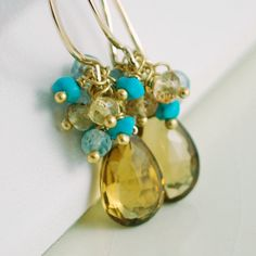 Beer quartz is such a lovely, deep gold colour. Here I've paired them with bright turquoise, aquamarine and yellow sapphires.