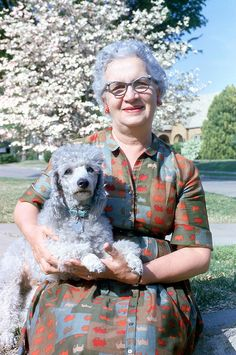 I aspire to be this woman someday.  Dignified, dressed spunky and sporting some mighty fine cat eye glasses, holding my beloved furbaby.