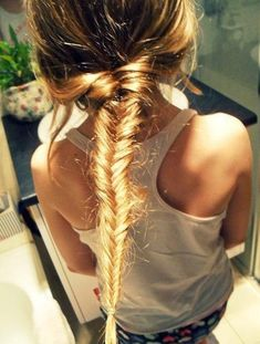 15 Hair Ideas You Need to Try This Summer - Opt for a messy fishtail braid for outdoor activities like a bike ride or rollerblading session with friends.