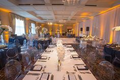 We just love sharing photos from our events. This shows off a mix of white acrylic tables and our Navy Claremont sequinned table linen.