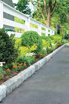 Adding a neat row of Belgian block stones to each side of an asphalt driveway…