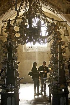 chandelier made outof human bones and skulls