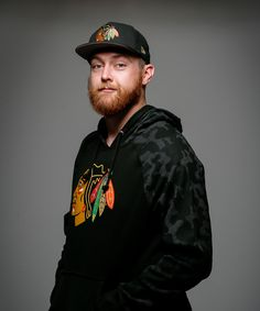 Scott Darling is wearing the 47 Brand Stealth Hoodie and the New Era Team Hasher Cap. These items are available at the Blackhawks Store and can be purchased over the phone by calling 312-759-0079!