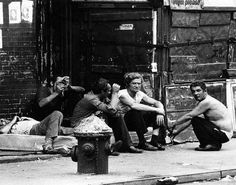 In another raw image from the photographer, a group of men cluster together during a dark time in the city's history. The Lower East Side was transformed in the 90s, with gentrification contributing to the trendy Bowery neighborhood of today.