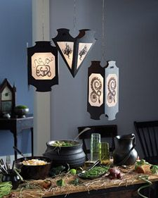 "Giant gothic lanterns hang ominously over the buffet; using our instructions, clip-art designs, and simple supplies, this project is almost as easy as saying ""abracadabra.""  Retrieved from Martha Stewart crafts."
