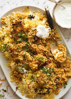 Chicken Biryani on a large serving platter, garnished with coriander with a side of minted yoghurt.Chicken Biryani on a large serving platter, garnished with coriander with a side of minted yoghurt. Top Recipes, Asian Recipes, Dinner Recipes, Cooking Recipes, Healthy Recipes, Recipies, Healthy Meals, Healthy Food, Cooking Broccoli
