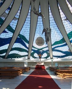 Cathedral of Brasilia (1970)  In 1988, at 81, Oscar Niemeyer was awarded the Pritzker Architecture Prize, the most prestigious award in architecture, for this cathedral..... a view of the altar with three angel figures suspended above